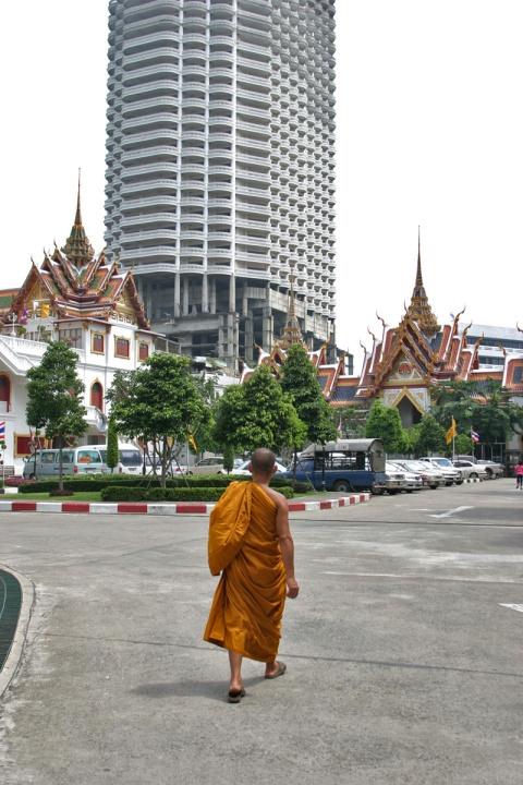 Monk walking in Bangkok