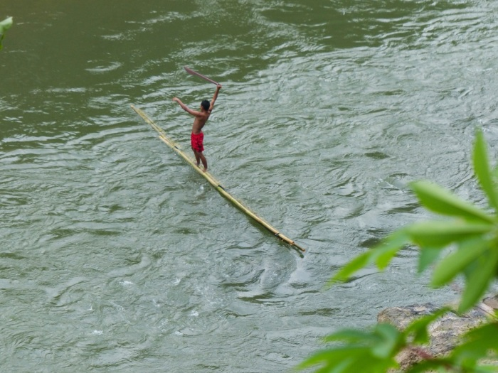 Almost falling off the bamboo raft