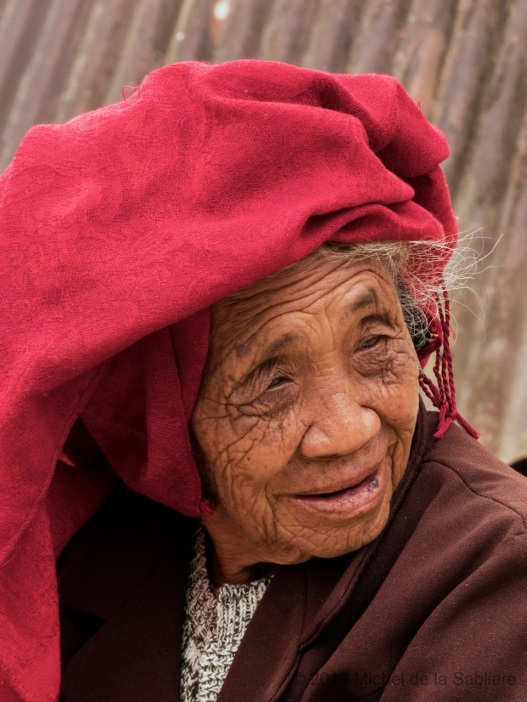 Old woman in red scarf