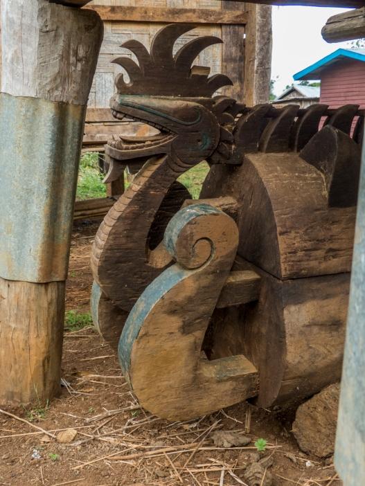 Ornate snake carved into Shaman casket