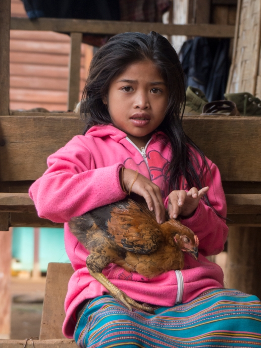 Girl and pet chicken