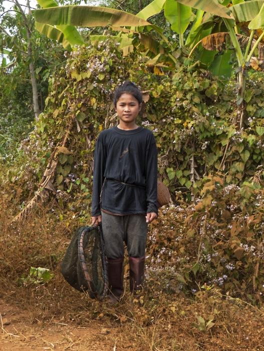 Katu girl fishing near the village
