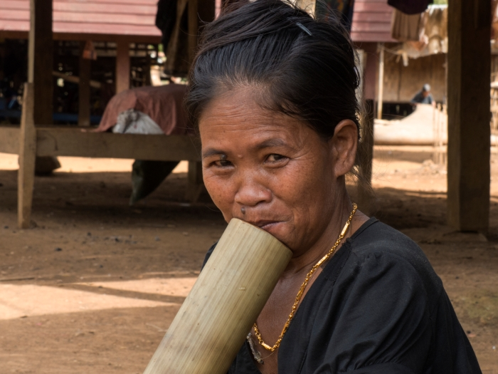 Katu woman smoking a traditional water pipe