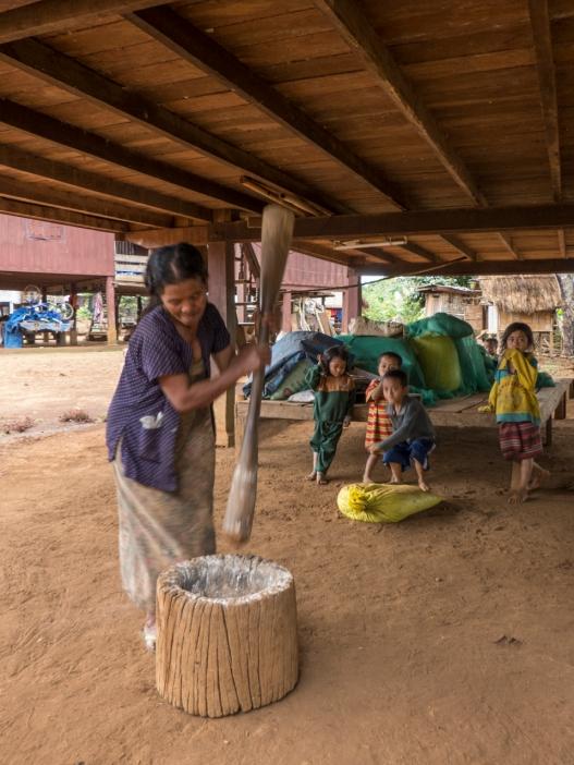 Woman grinding Manioc