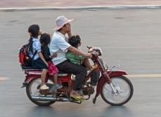many kids on a moto