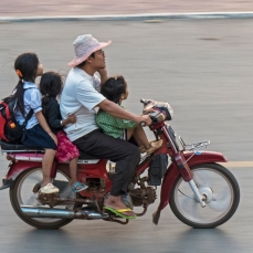 many kids on a moto