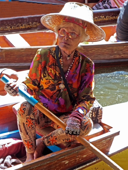 A woman at the floating market in Thailand - she is cool!