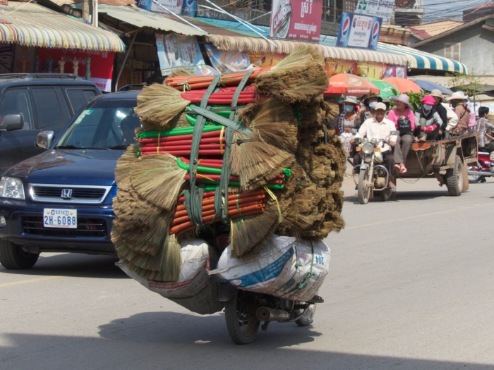 How many brooms can you fit on a motorcycle