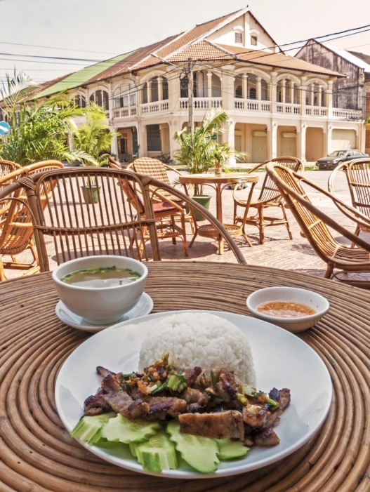 Carmelized Pork and Rice in front of French Colonial Building