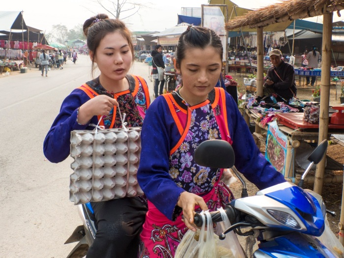 Lisu carrying eggs on their motorbike