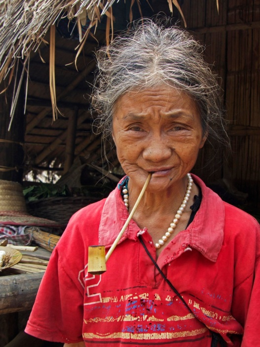 Akha woman with pipe