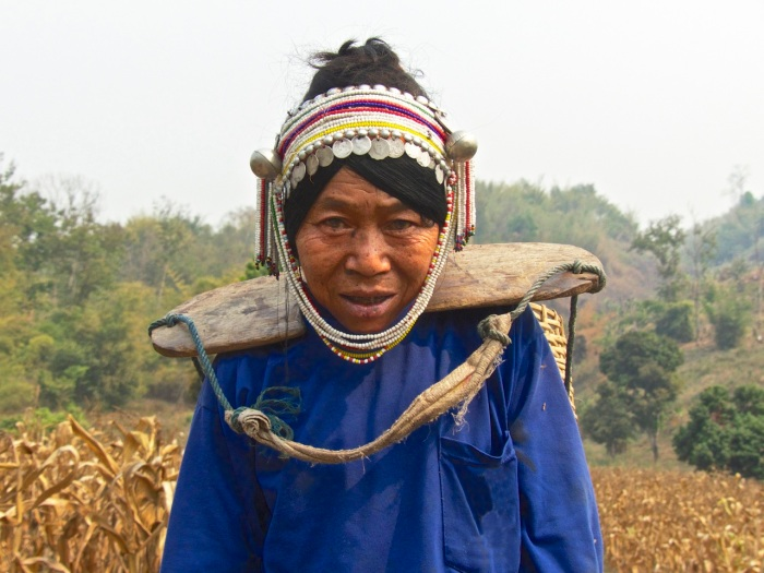 Woman carrying a heavy load