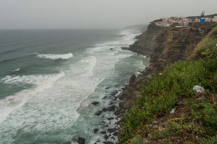 A cliff town over looking a stormy sea