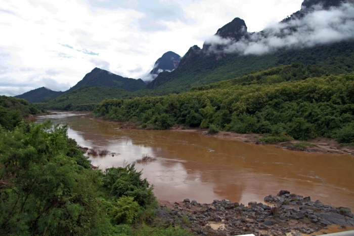 Windy Brown River and Limestone Mountains