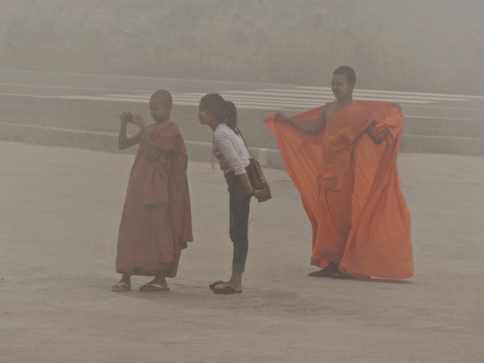 Cambodia - 2 Monks and a girl 1000 feet in the fog Bokor