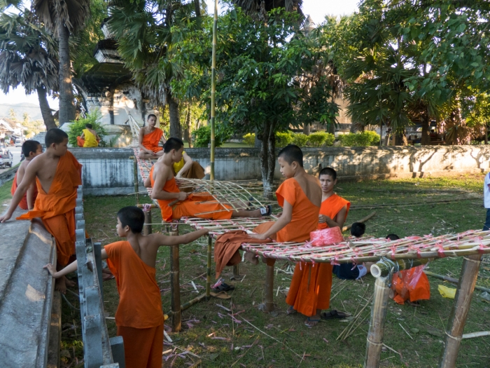 Laos - Monks building a boat for the festival LP