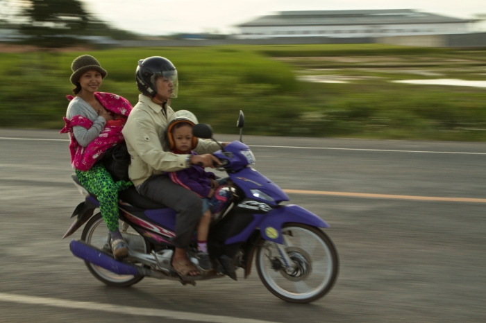 Cambodia - Family together on their moto, normal life